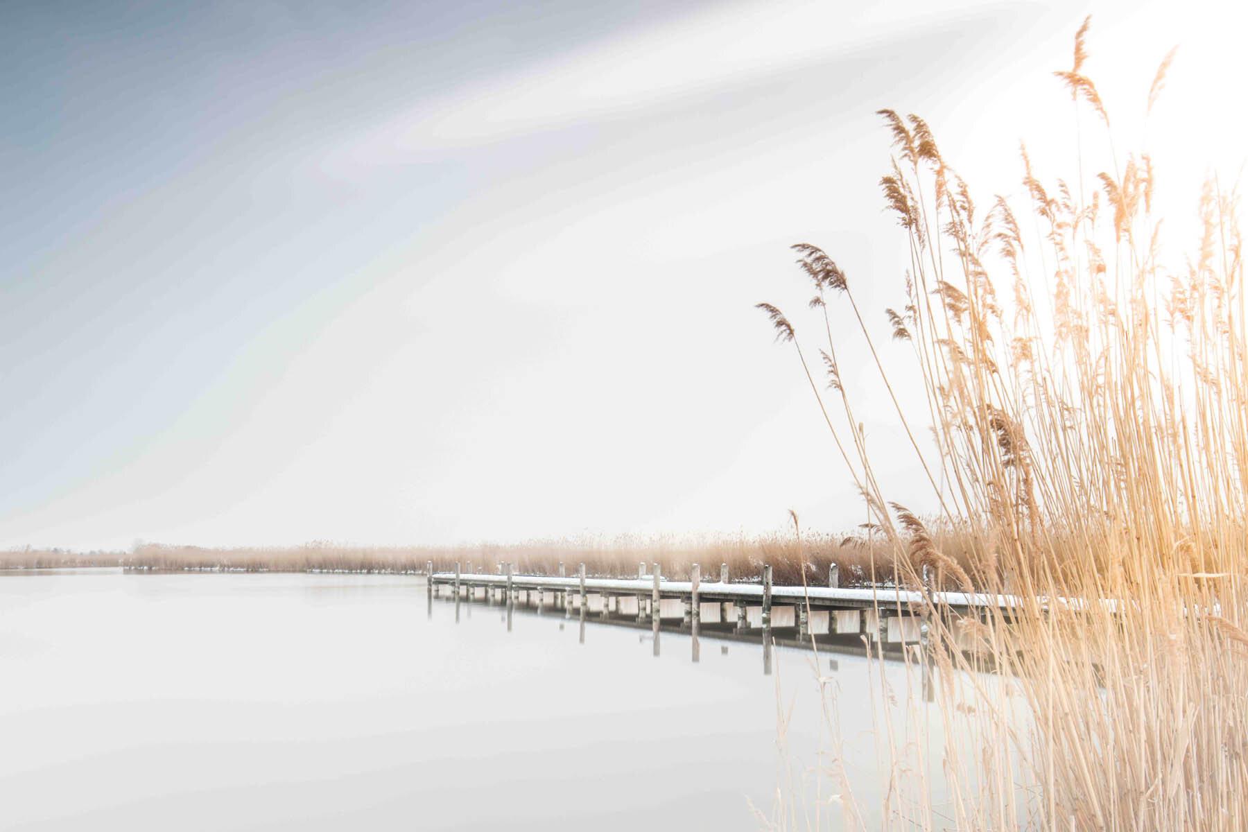 PlateART Duschrückwand mit Motiv Strand und Meer Steg Winter